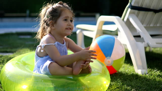 Gorgeous toddler playing by the pool