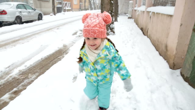 gorgeous toddler running on a snowy day - candid stock videos & royalty-free footage