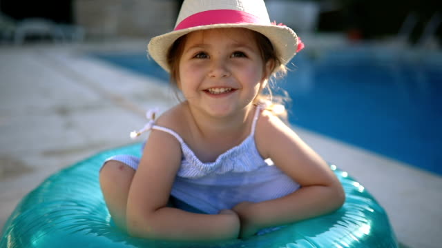 gorgeous toddler sitting in a inflatable ring - standing water stock videos & royalty-free footage