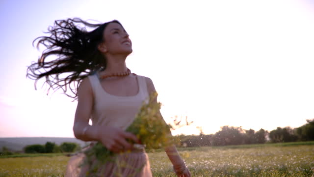 gorgeous woman having fun on a dandelion meadow - satisfaction stock videos & royalty-free footage