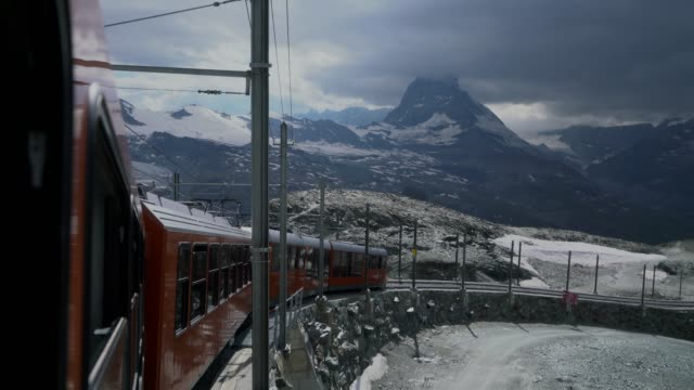 gornergrat train driving in swiss alps - hill stock videos & royalty-free footage