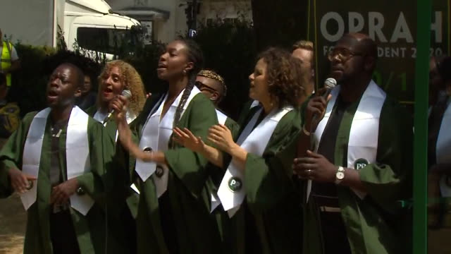gospel singers singing whilst holding signs saying 'oprah for president 2020' during donald trump's first visit to the uk as president - oprah winfrey stock videos & royalty-free footage
