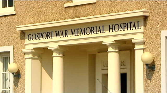 jury finds inappropriate medication killed three patients ext entrance to gosport war memorial hospital nurse administering sedative to patient - 鎮静薬点の映像素材/bロール