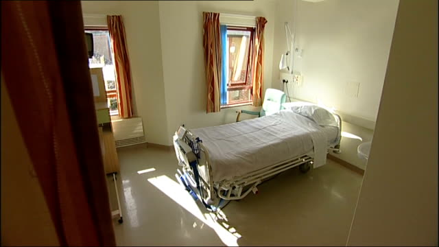 gosport memorial hospital inquest begin curtain opening to reveal bed in ward shot of nurses towards - gosport stock videos & royalty-free footage