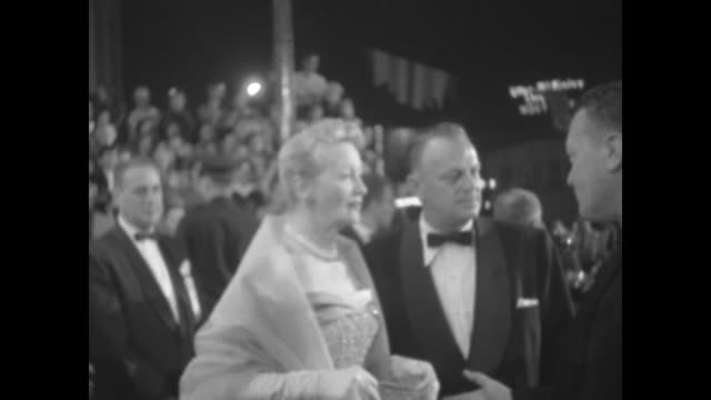 gossip columnist hedda hopper with two men outside the hollywood theater at which a star is born is premiering - columnist stock videos & royalty-free footage