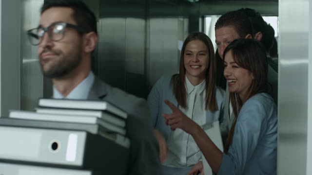 Gossiping in an elevator