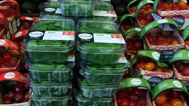 gotham greens products at brooklyns flagship whole foods market in greenpoint new york on may 15 gotham greens and grown right upstairs signage on a... - whole foods market stock videos and b-roll footage