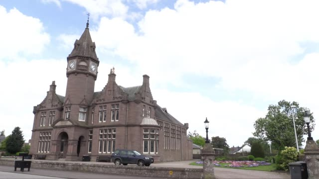 a gothic building gifted to the village by sir robert inglis in 1896 in memoriam of his father it now houses the local library edzell itself is a... - スコットランド ダンディー点の映像素材/bロール