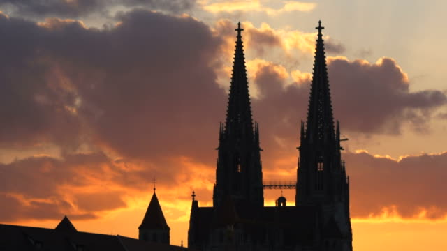 t/l gothic cathedral steeples in front of moody sky - regensburg stock videos & royalty-free footage