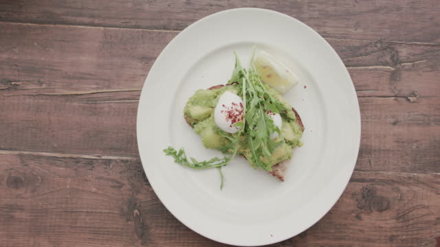 gourmet meal with avocado, egg and bread - plate stock videos & royalty-free footage