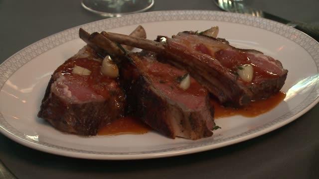 wgn gourmet plated lamb chops at maple ash restaurant in chicago on february 17 2016 - kotelett stock-videos und b-roll-filmmaterial