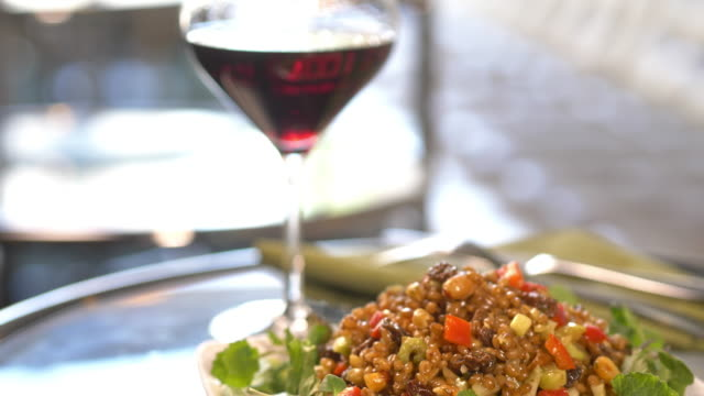 gourmet salad with wheat berry, peppers, cucumber, and raisin. - raisin stock videos & royalty-free footage
