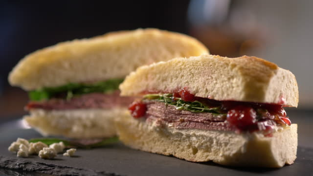 gourmet sub sandwich cut in half - french bakery stock videos & royalty-free footage