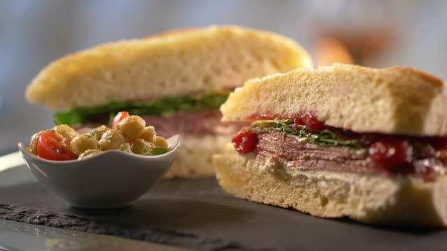 gourmet sub sandwich cut in half - sandwich stock videos & royalty-free footage
