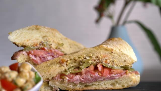 vídeos de stock, filmes e b-roll de gourmet sub sandwich with cured meats and dijon mustard. - conserva