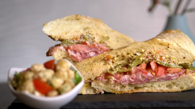 gourmet sub sandwich with cured meats and dijon mustard. - pane a lievito naturale video stock e b–roll
