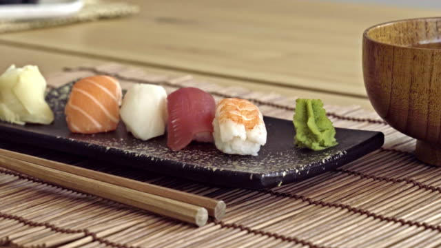 gourmet sushi on a plate with miso soup and chopsticks - wasabi stock videos and b-roll footage