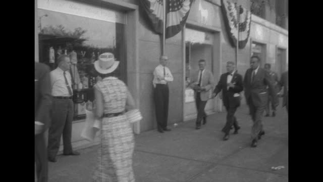 vidéos et rushes de il gov adlai stevenson posing for photo opportunity / three shots of ny gov averell harriman walking with men on sidewalk / harriman entering... - adlai stevenson