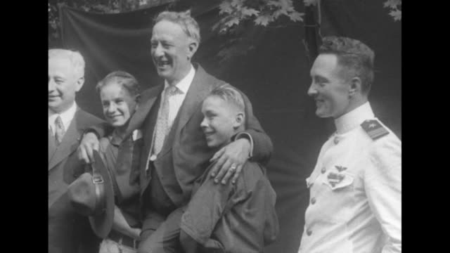 ny gov al smith and explorer richard e byrd wearing dress whites pose with others / smith broadly smiles and poses with his hands on shoulders of two... - headdress stock videos & royalty-free footage
