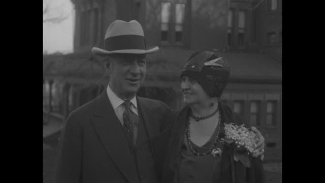 stockvideo's en b-roll-footage met ny gov al smith and his wife catherine stand outdoors with their great dane dog / closer view of the smiling couple / cu smiling smith / smith plays... - al smith