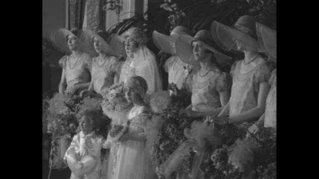 CU Gov Al Smith's daughter Catherine wearing hat and fur smiling / CU fiance Francis Quillinan / pan up Catherine in wedding gown holding bouquet /...