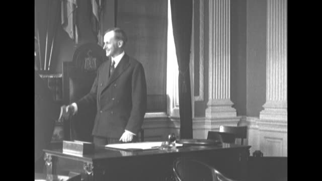 gov calvin coolidge and sen hiram johnson shake hands in coolidge's office / 2shot the two men - 1910 1919 stock videos and b-roll footage