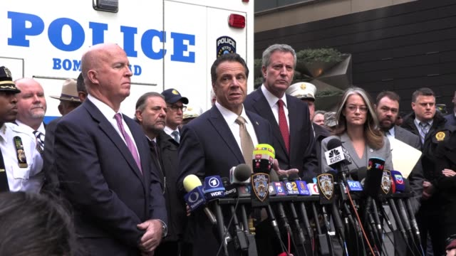gov cuomo and nypd press conference nypd presence as time warner building evacuated because of suspicious pipe bomb delivered to cnn offices - governor stock videos & royalty-free footage