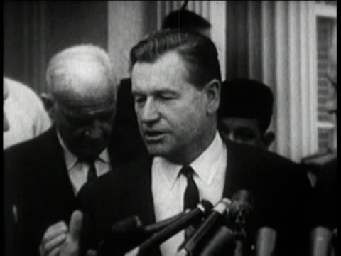 gov rockefeller speaking to reporters / man with video camera - ネルソン a ロッカフェラー点の映像素材/bロール