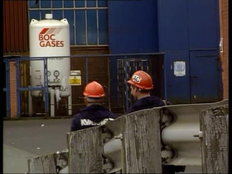 Govan shipyard jobs saved Cranes at shipyard Sign 'Kvaerner' on side of building Workers away Welder working i/c