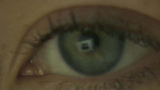 Government' accused of failing to implement guidleines to protect children online T101117025 / Close shot of eye