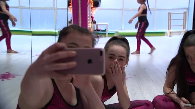 Government' accused of failing to implement guidleines to protect children online ENGLAND Teesside INT Girl practising in dance studio Girl taking...