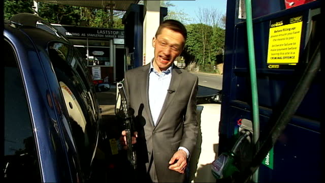 government accused of fuelling petrol shortages over its response to proposed strike north england car arriving at esso petrol station 'sorry out of... - unleaded stock videos and b-roll footage