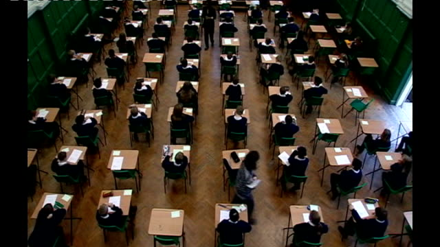 government agrees to end science sat exam taken by 11yearolds england int various of schoolchildren seated at desks in examination hall brighton... - head teacher stock videos & royalty-free footage