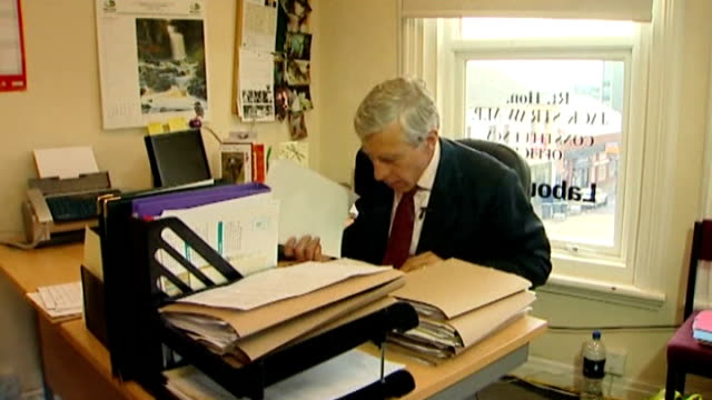 uk government agrees to pay libyan man over 2 million pounds to settle rendition case t09091121 / tx blackburn int jack straw mp working at desk in... - jack straw stock videos & royalty-free footage