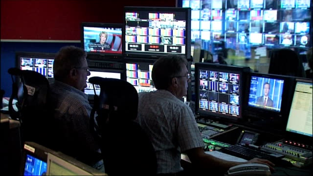 government allows rupert murdoch to take over bskyb reporter to camera gvs producers in television gallery and producers watching screens control... - andrew neil stock videos & royalty-free footage