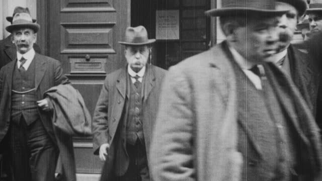 stockvideo's en b-roll-footage met 1921 ws government and miners' federation team members exit the board of trade building after negotiations / united kingdom - 1921