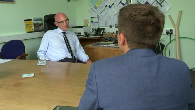 government announce biggest public sector pay rise in decade; uk, west sussex, horsham: headteacher interview. england: west sussex: horsham: ext... - west sussex stock videos & royalty-free footage