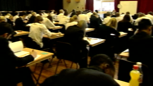 baccalaureate to replace gcses file date location unknown int students taking exam in examination hall - 試験点の映像素材/bロール