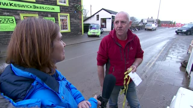 government announce spending on flood defences cumbria keswick ext various shots flood damaged furniture by walls and on pavements outside houses... - cracker stock videos and b-roll footage