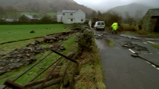 government announce spending on flood defences; england: cumbria: ext low cloud over hills close shot hill or mountain car away through flooded... - extreme weather stock videos & royalty-free footage