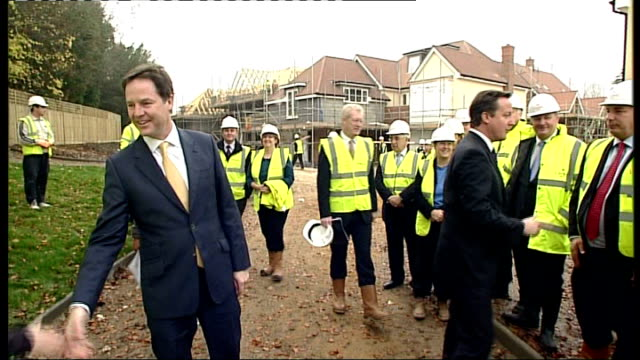 government announces 400 million pounds to be invested in building new homes england surrey guildford ext workman sawing through length of mdf on... - guildford stock videos and b-roll footage