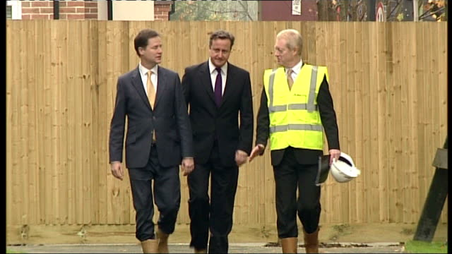 government announces 400 million pounds to be invested in building new homes surrey guildford clegg and cameron along sign on new housing estate... - guildford stock videos and b-roll footage