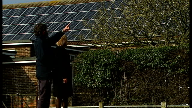 Government announces home insulation scheme Solar panels PULL ITN reporter along with Sam Clarke Sam Clarke interview SOT Anonymous shots school...