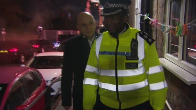 vidéos et rushes de government announces new knife crime strategy england london police officer chatting as along with sajid javid mp on housing estate - aménagement de l'espace