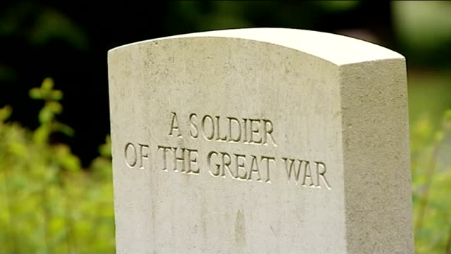 government announces world war i centenary events belgium ext close shot gravestone with inscription reading 'a soldier of the great war' general... - 彫刻画点の映像素材/bロール