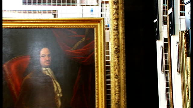 Government Art Collection to go on public display for first time ENGLAND London INT Reporter to camera in office of Ed Vaizey pointing out paintings...