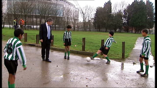 government backs england's bid to host the 2018 world cup; **beware flash photography** brown kicking football about with group of young footballers... - boys beware点の映像素材/bロール