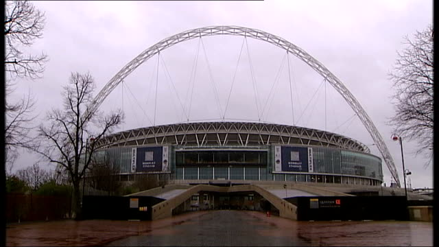 government backs england's bid to host the 2018 world cup; england: london: wembley stadium: ext **football supporters singing 'que sera sera'... - wembley stadium stock videos & royalty-free footage