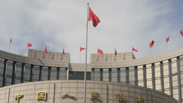 government bank of china in beijing city - chinese flag stock videos & royalty-free footage