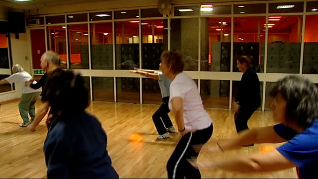 Government 'Be Active Be Healthy' campaign to get people exercising ENGLAND London INT Group of pensioners exercising in studio Vox pop Group of old...